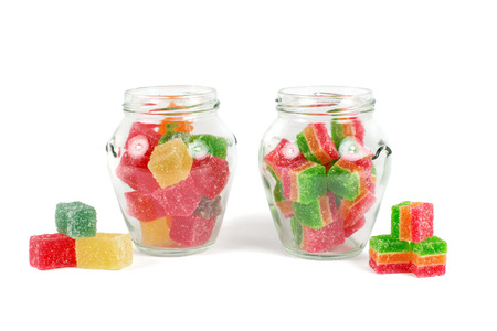 Glass jars filled with different colorful jelly photo