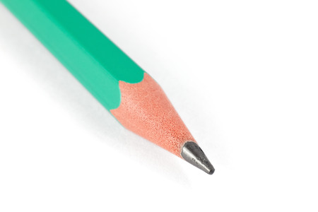 Macro shot of green pencil isolated on white background photo