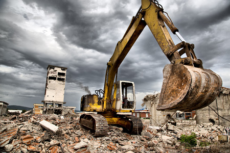 Bulldozer removes the debris from demolition of old derelict buildings 版權商用圖片