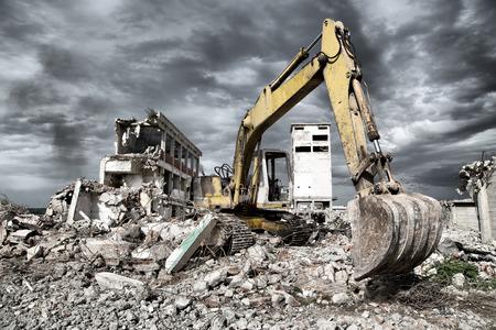 detritus: Bulldozer removes the debris from demolition of old derelict buildings Stock Photo