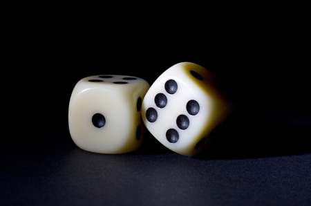 Two White Dices Isolated on Black Background Stock Photo - 34426137