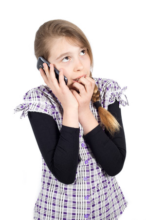 Young Teenage Girl Frightened by the Threatening Phone Calls Mobile Phone Abuse Concept. Studio Shot Isolated on White photo