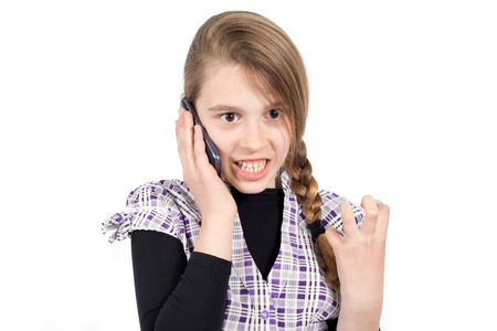 unpleasant: Furious Girl With Clenched Left Hand Expressing Anger Because of Unpleasant Phone Call. Studio Shot Isolated on White
