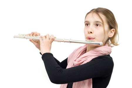 Young Talented Girl Practicing Flute Indoors. Half Length Studio Shot Isolated on White photo