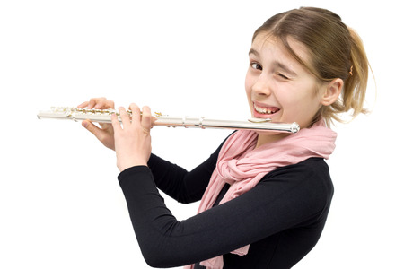 Cheerful Teenage Girl Holding Flute and Winking into the Camera. Half Length Studio Shot Isolated on White Background photo