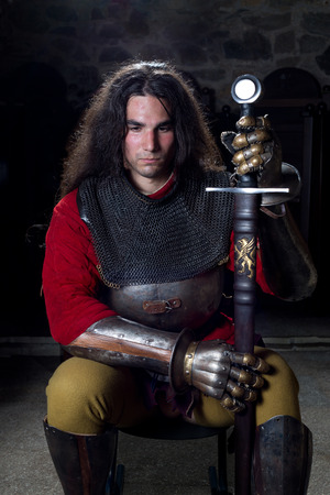 hauberk: Portrait of Brave Warrior With Sword