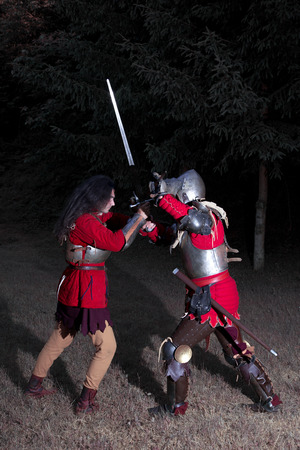 hauberk: Two Knights in Battle in Dark Forest, Side View