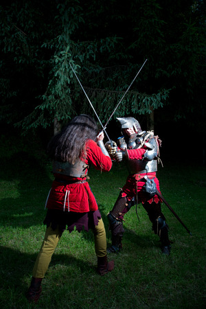 hauberk: Two Knights Fencing in the Woods at Night Stock Photo