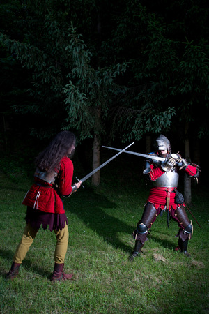hauberk: Fencing Duel Between Two Knights in Armor in the Forest Stock Photo
