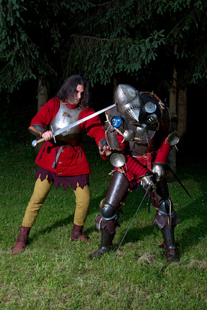 hauberk: Fight Scene Between Two Medieval Knights in the Forest at Night Stock Photo