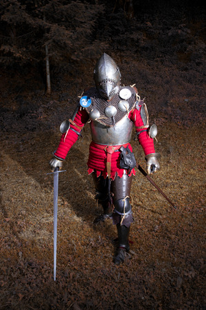 Medieval Warrior in Knights Suit Standing in Dark Forest Ready for Battle