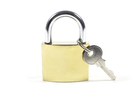 unsolved: Locked Padlock And Key Isolated On White Background, Studio Shot