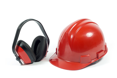 protector: Red Hardhat And Ear Protector Isolated On White Background Stock Photo