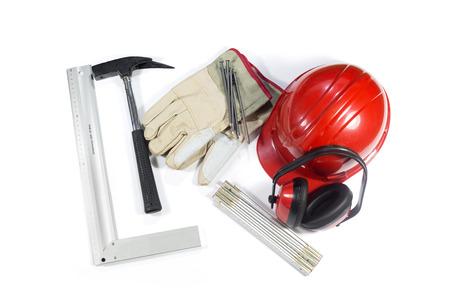 hammer and nails: Set Of Building Tools - Protective Earmuffs, Hammer, Nails, Gloves, Protective Helmet And Folding Ruler Isolated On White Background Stock Photo