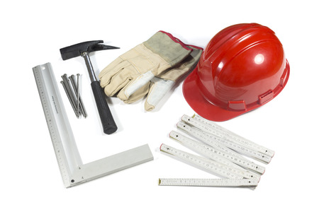 hammer and nails: Construction Tools - Protective Hardhat, Gloves, Hammer, Nails And Straightedge Isolated On White Background