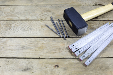 hammer and nails: Hammer, Nails And Folding Ruler On Wooden Planks Stock Photo