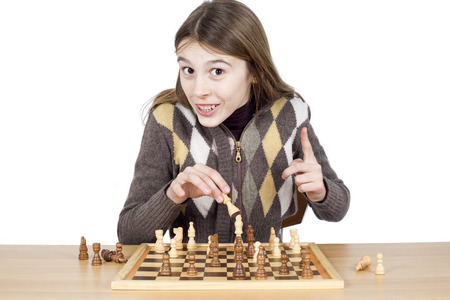 outwit: Cheerful Young Girl With A Forefinger Up Looking At Camera Making A Good Move In Chess, Got Idea Gesture, Positive Emotion, Isolated On White Background