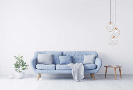 Grey pillows above blue Scandinavian sofa in modern interior. wooden side table with gold elegant home accessories. Green plant vase. White wall mock up. Minimal concept design