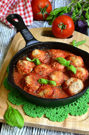 sause: Meatballs with rice baked in tomato sause. Stock Photo