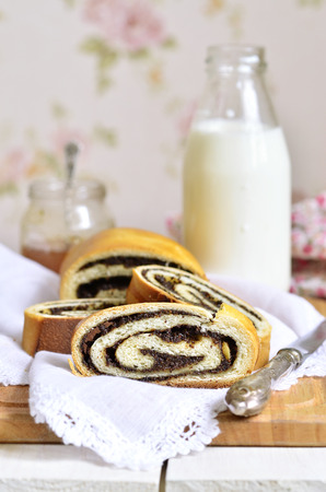 Roll with poppy seed and milk for a breakfast. photo