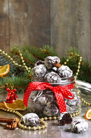 crinkles: Cookies Chocolate crinkles in a jar on a festive background.