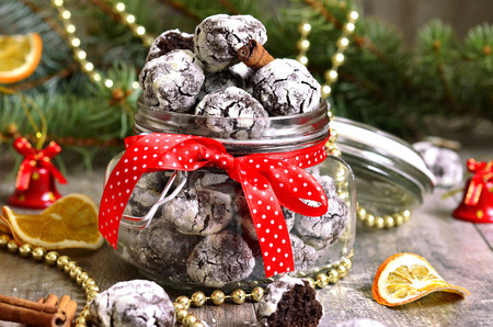 crinkle: Cookies Chocolate crinkles in a jar on a festive background.