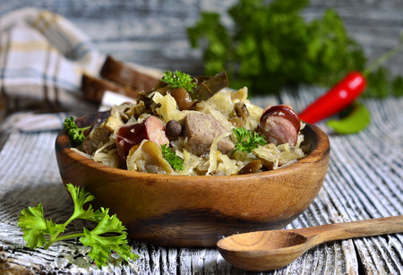 Bigos-traditional dish of polish cuisine from sour and fresh cabbage,meat and mushrooms.