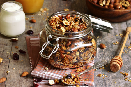 breakfast cereal: Granola from several types of cereals with nuts,coconut chips and dried cranberry.