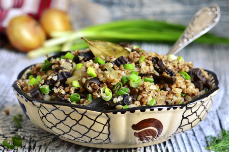 meatless: Buckwheat with dried mushrooms and fried onion - traditional dish of russian cuisine. Stock Photo