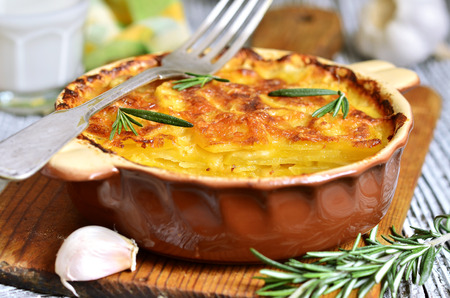 prepared potato: Potato slices baked in milk with cheese,garlic and herb in rustic style.