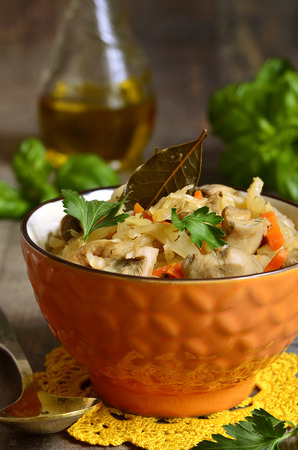 stewed: Cabbage stewed with mushrooms in a bowl.