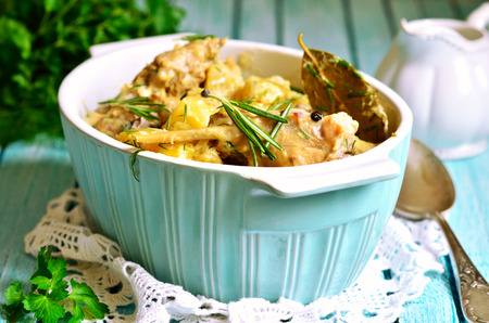 Rabbit stewed with potato in a cream sauce,rustic style.