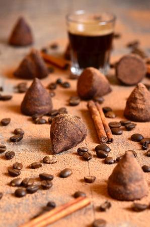 Homemade chocolate vanilla and coffee truffles with glass of coffee. photo