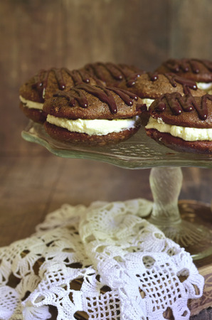mascarpone: Chocolate whoopie with mascarpone on wooden background. Stock Photo