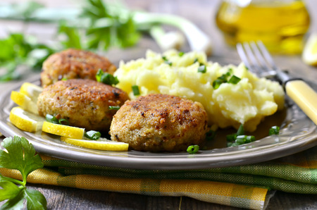 chicken burger: Fish cutlets with greens. Stock Photo