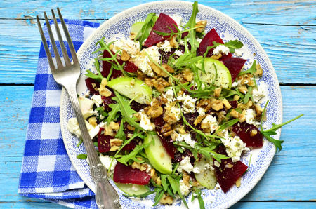 Beet salad with feta,apple,walnut and arugula.Top view. Stock Photo