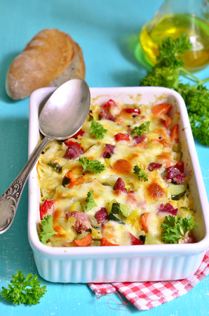 Vegetable casserole with pork shank and cheese. Archivio Fotografico