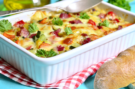 shank: Vegetable casserole with pork shank and cheese. Stock Photo