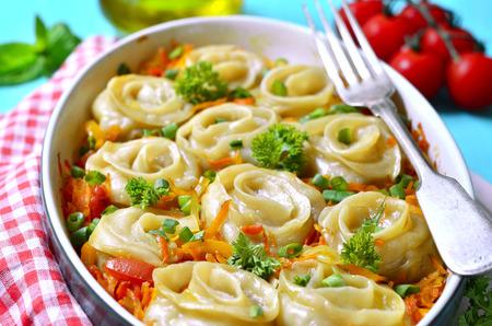 Dumplings Meat roses baked in vegetable sauce. Stock Photo