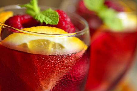 Homemade delicious sangria with orange and raspberry.