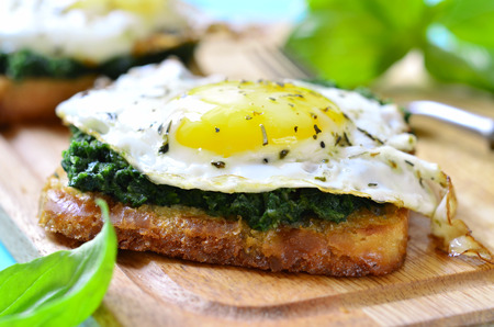 eggs: Toast with spinach and fried egg for breakfast. Stock Photo