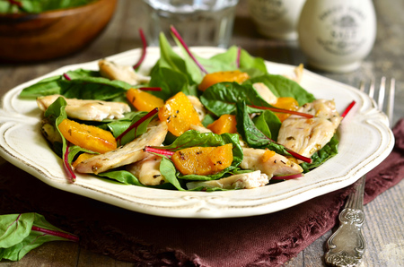 Warm chard salad with pumpkin and chicken.Rustic style.
