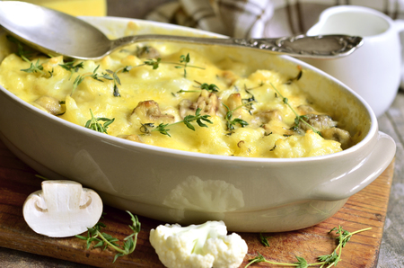 Baked cauliflower with mushrooms,thyme and cheese in bechamel sauce.