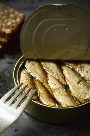 gold cans: Can with smoked Baltic sprats and fork