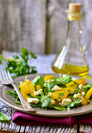 Spinach salad with roasted pumpkin,feta cheese and parsley
