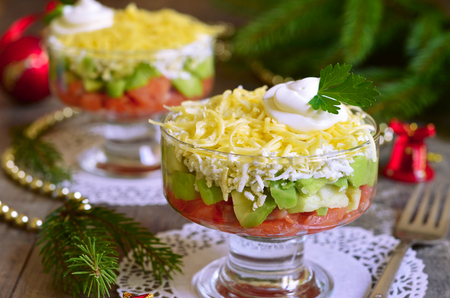 fruit salad: Avocado salad with salt salmon,egg and cheese on a turquoise wooden table. Stock Photo