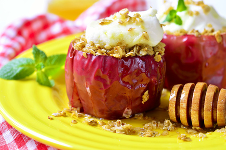 mascarpone: Baked apples with granola,honey and mascarpone - healthy breakfast. Stock Photo
