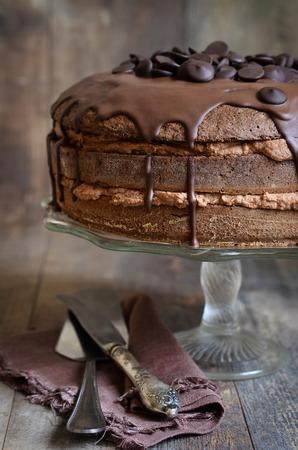 Chocolate cake with mascarpone on rustic background. 스톡 콘텐츠