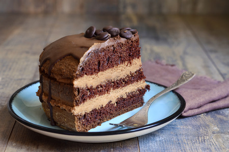mascarpone: Chocolate cake with mascarpone on rustic background. Stock Photo