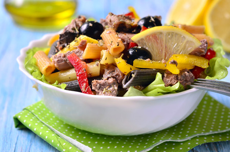 Tuna salad with pasta and bell pepper. Фото со стока